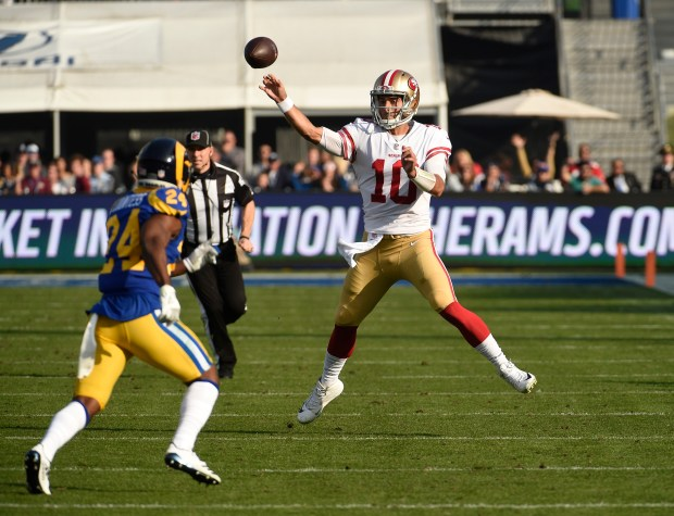 Quarterback Jimmy Garoppolo #10 of the San Francisco 49ers throws a pass against Blake Countess #24 of the Los Angeles Rams during the second quarter at Los Angeles Memorial Coliseum on December 31, 2017 in Los Angeles, California. (Photo by Kevork Djansezian/Getty Images)