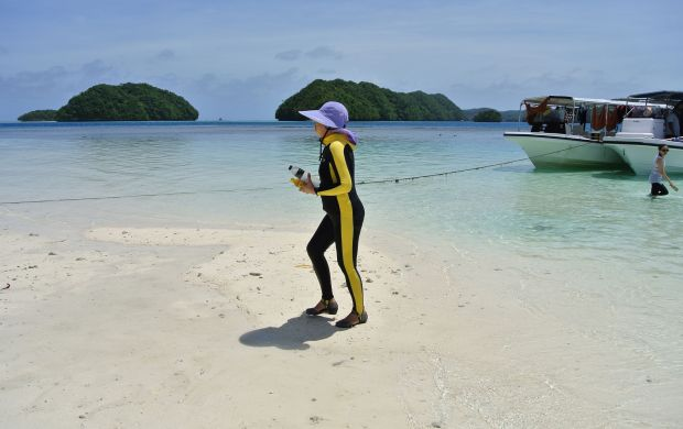(FILES) This file picture taken on March 6, 2015 shows a Chinese tourist walking on a beach on the Rock Islands in Palau. AFP PHOTO / SEBASTIEN BLANCSEBASTIEN BLANC/AFP/Getty Images