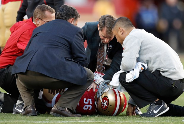 San Francisco 49ers' Reuben Foster (56) is checked out by 49ers staff during their game against the Tennessee Titans in the fourth quarter of their NFL game at Levi's Stadium in Santa Clara, Calif., on Sunday, Dec. 17, 2017. (Nhat V. Meyer/Bay Area News Group)