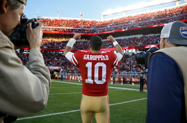 San Francisco 49ers starting quarterback Jimmy Garoppolo (10) celebrates towards fans following their 25-23 win against the Tennessee Titans for their NFL game at Levi's Stadium in Santa Clara, Calif., on Sunday, Dec. 17, 2017. (Nhat V. Meyer/Bay Area News Group)