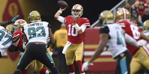 San Francisco 49ers quarterback Jimmy Garoppolo (10) throws a pass against Jacksonville Jaguars during the first quarter of their NFL game at Levi's Stadium in Santa Clara, Calif., on Sunday, Dec. 24, 2017. (Jose Carlos Fajardo/Bay Area News Group)