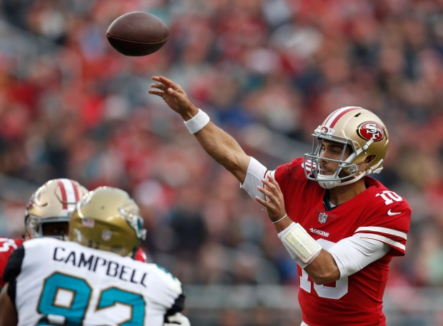 San Francisco 49ers starting quarterback Jimmy Garoppolo (10) throws a touchdown pass to San Francisco 49ers' George Kittle (85) against the Jacksonville Jaguars in the third quarter of their NFL game at Levi's Stadium in Santa Clara, Calif., on Sunday, Dec. 24, 2017. (Nhat V. Meyer/Bay Area News Group)