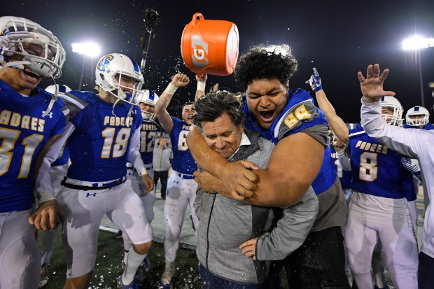 Serra head coach Patrick Walsh is doused with water by his players after defeating Cajon during their 2017 CIF State Football Championship Division 2-AA Bowl Game at Sacramento State University in Sacramento, Calif. on Friday, Dec. 15, 2017. Serra defeated Cajon 38-14. (Jose Carlos Fajardo/Bay Area News Group)