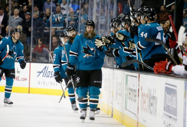 San Jose Sharks' Joe Thornton (19) celebrates with bench after scoring goal agains the Carolina Hurricanes in the second period of their NHL game at SAP Center in San Jose, Calif., on Thursday, December 7, 2017. (Josie Lepe/Bay Area News Group)