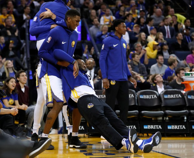 The Golden State Warriors bench celebrates a basket by the Warriors against the Memphis Grizzlies in the fourth quarter at Oracle Arena in Oakland, Calif., on Wednesday, Dec. 20, 2017. (Nhat V. Meyer/Bay Area News Group)