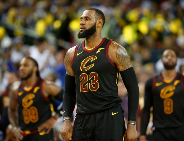 16f50fcbe9d Cleveland Cavaliers  LeBron James (23) walks down the court during the  fourth quarter