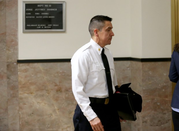 """Oakland Fire Marshal Miguel Trujillo leaves the courtroom during a break in a preliminary hearing for Derick Almena and """"Ghost Ship"""" co-defendant Max Harris at the René C. Davidson Courthouse in Oakland, Calif., on Wednesday, Dec. 13, 2017. (Anda Chu/Bay Area News Group)"""