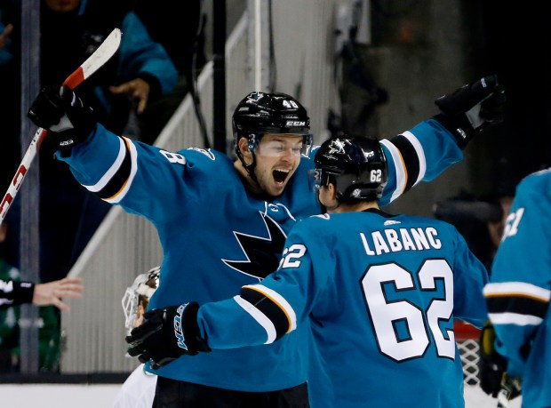 San Jose Sharks's Tomas Hertl (48) celebrates an overtime goal with Kevin Labanc (62), as they win 5-4 against the Vancouver Canucks in their NHL game at the SAP Center in San Jose, California on Thursday, Dec. 21, 2017. (Josie Lepe/Bay Area News Group)