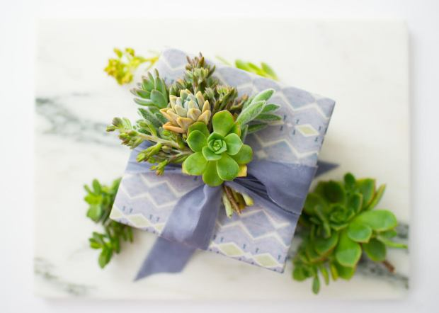 Garden trimmings make for festive and eco-friendly toppings for gifts. Plus, they are bio-degradable, unlike some bows and adornments. (Courtesy Wrappily)