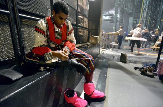 """Lawrence Rines, a dancer with the Boston Ballet, laces his shoes for hisrole as the lead Russian in """"The Nutcracker."""" MUST CREDIT: Photo for The Washington Post by Josh Reynolds"""