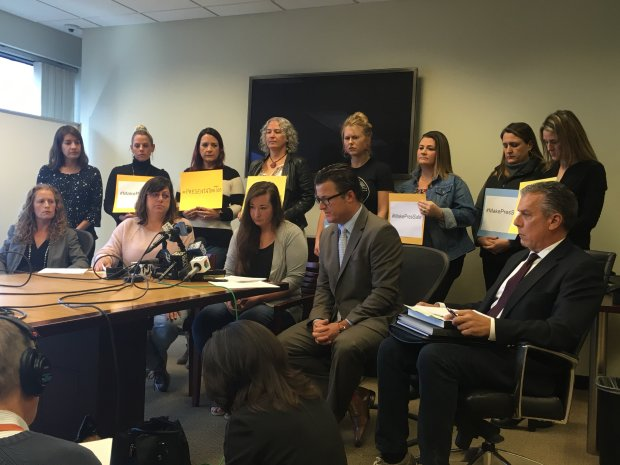 Alumnae of Presentation High School, standing, support one victim and themother of another victim, seated, at a news conference held on Dec. 19, 2017, by San Jose attorney Robert Allard, seated, center, and his investigator, former San Jose Police Sgt. Michael Leininger, right. (Sharon Noguchi/Bay Area News Group)