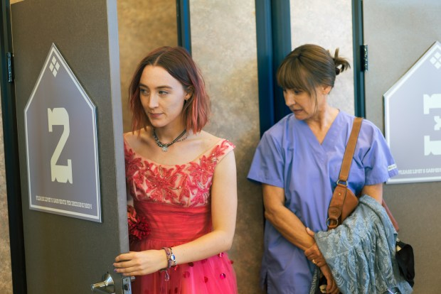 "This image released by A24 Films shows Saoirse Ronan, left, and Laurie Metcalf in a scene from ""Lady Bird."" (Merie Wallace/A24 via AP)"