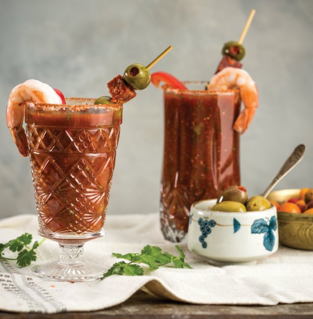 "This Gazpacho-inspired cocktail from Ellen Brown's ""The Bloody Mary Book"" gets its Spanish kick from harissa and olive, chorizo and shrimp garnishes. (Photo courtesy of SteveLegato)"
