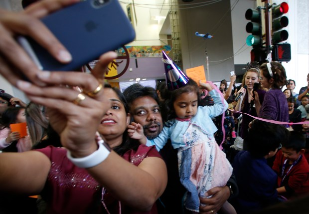 Sandhya Sundarababu takes a family selfie with her husband Jai and their daughter, Mithra, at the Children's Discovery Museum of San Jose New Year's Eve celebration, Sunday, Dec. 31, 2017, in San Jose, Calif. (Karl Mondon/Bay Area News Group)