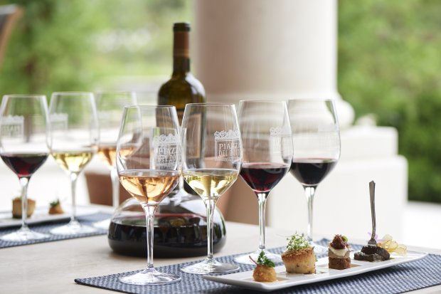 A Poppers tasting experience at Napa's new Piazza Del Dotto winery pairsfour savory bites with a flight of five wines. (Courtesy of Marc Fiorito)
