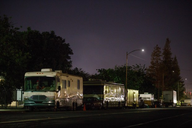 RVs are seen parked on South 7th Street in San Jose on Dec. 5, 2017. Government officials and homeless advocates have seen an increase in the number of working poor residents living in RVs on public streets. (Dai Sugano/Bay Area News Group)