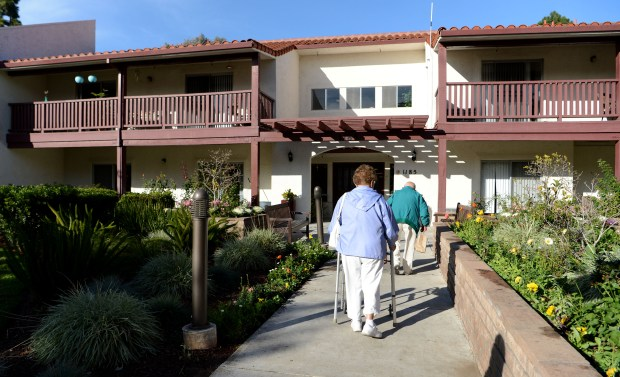 Residents walk into the Atria Chateau Gardens assisted living facility in San Jose, Calif., on Friday, Nov. 1, 2017. This facility will have to shut down in February because Westlake Realty Group has decided not to renew its lease. The announcement was made to the residents this week and will displace the some 80 current residents who will have 60 days to find a new place to live. Atria is doing its best to assist residents in their search for housing. (Dan Honda/Bay Area News Group)