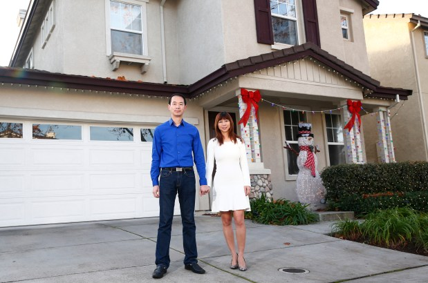 Michael Cheng and Tina Lam are photographed in front of their home in San Jose, California, on Friday, Dec. 1, 2017. The couple had bought a private, exclusive street, that adjoins the mansions in the Presidio Terrace neighborhood in San Francisco for $90,000 in an auction in 2015. The residents failed to pay property taxes on the land for decades. San Francisco officials recently reversed the tax default sale. Cheng and Lam plan to fight the decision. (Gary Reyes/ Bay Area News Group)