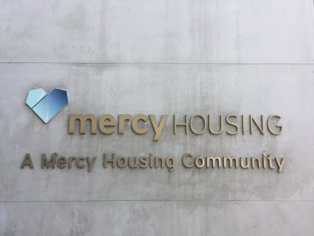 A Mercy Housing sign is visible outside an affordable housing developmentin San Francisco's Mission Bay neighborhood. The building couldn't have been completed without substantial help from the tax credits the GOP tax plan threatens to eliminate. (Marisa Kendall/ Bay Area News Group)
