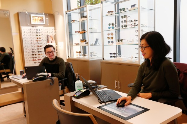 Opticians, James Huynh, and Wendy Paiyou, left to right, work in the full-service optometry department at the Crossover Health medical clinic in Sunnyvale, California, on Thursday, Dec. 7, 2017. Some Silicon Valley tech companies have contracts with health care companies like Crossover Health to provide their employees with primary health services completely outside of the traditional, fee-for-service model used by health insurance companies. (Gary Reyes/ Bay Area News Group)