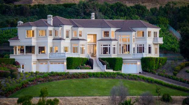 This 8,451-square-foot estate sits on 1.09 acres and features gardens that include a vineyard of 200 Zinfandel grape vines.