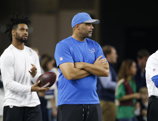 Detroit Lions defensive coordinator Teryl Austin watches the team warm up before an NFL football game against the Dallas Cowboys on Monday, Dec. 26, 2016, in Arlington, Texas. (AP Photo/Michael Ainsworth)