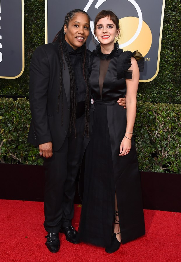 Marai Larasi, left, and Emma Watson arrive at the 75th annual Golden Globe Awards at the Beverly Hilton Hotel on Sunday, Jan. 7, 2018, in Beverly Hills, Calif. (Jordan Strauss/Invision/AP)