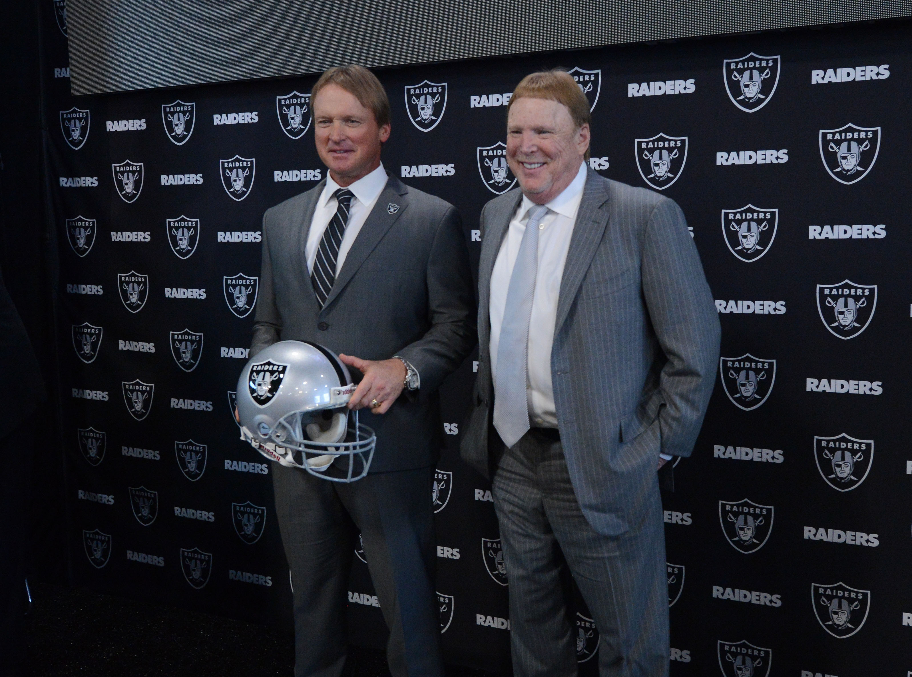 Jon Gruden poses with owner Mark Davis as the Oakland Raiders introduced their new head coach at the team facility in Alameda Calif. on Tuesday Jan. 9 2018