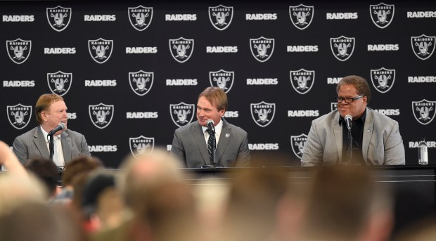 The Oakland Raiders' owner Mark Davis, left, and general manager Reggie McKenzie, right, introduce Jon Gruden as their new head coach at the team facility in Alameda, Calif., on Tuesday, Jan. 9, 2018.(Dan Honda/Bay Area News Group)