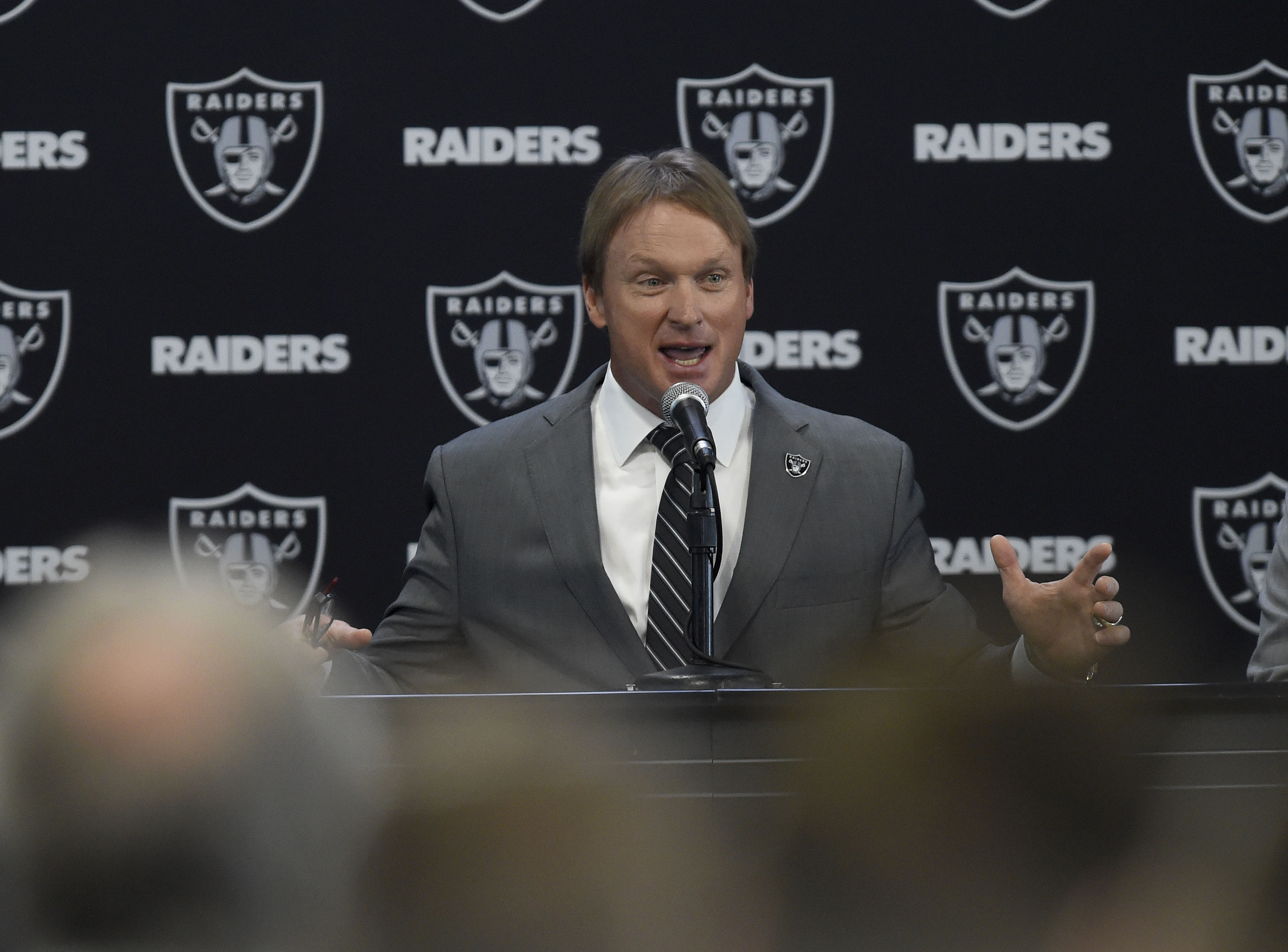 Jon Gruden answers questions from the media during the Oakland Raiders introduce him as their new head coach at the team facility in Alameda Calif. on Tuesday Jan. 9 2018