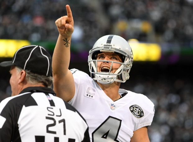 Oakland Raiders quarterback Derek Carr (4) points to the replay of Amari Cooper catching a touchdown pass in the first quarter of their NFL game against the Kansas City Chiefs at the Coliseum in Oakland, Calif. on Thursday, Oct. 19, 2017. (Doug Duran/Bay Area News Group)