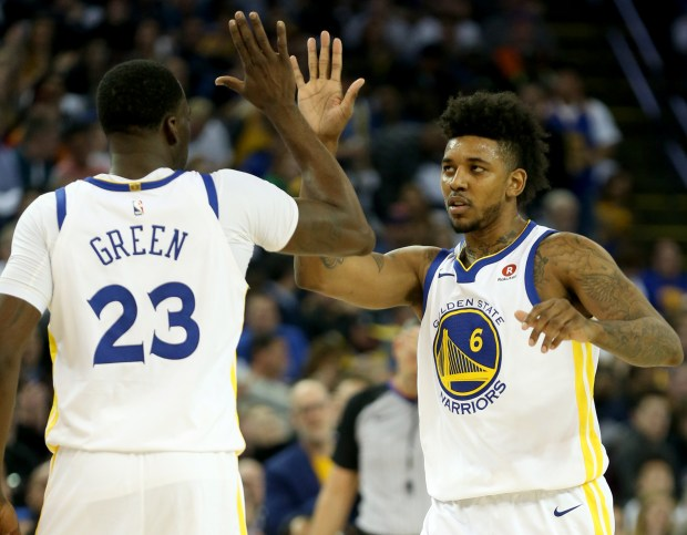 Golden State Warriors' Nick Young (6) celebrates a score with teammate Draymond Green (23) against the New York Knicks in the second period of a NBA game at Oracle Arena in Oakland, Calif., on Tuesday, Jan. 23, 2018. (Anda Chu/Bay Area News Group)