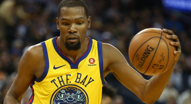 Golden State Warriors' Kevin Durant (35) wears the team's Chinese New Year jersey in the fourth period of a NBA game against the Minnesota Timberwolves at Oracle Arena in Oakland, Calif., on Thursday, Jan. 25, 2018. (Anda Chu/Bay Area News Group)