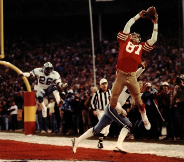 """San Francisco 49ers' receiver Dwight Clark hauls in a six-yard touchdown pass from Joe Montana with 51 seconds left in the 1982 NFC Championship game against the Dallas Cowboys. Immortalized in sports lore as """"The Catch,"""" Clark's reception capped an 87-yard drive that propelled the 49ers into the Super Bowl. The Cowboys play the 49ers in Sunday's NFC Championship game, the first such matchup since """"The Catch."""" (AP Photo/Dallas Morning News, Phil Huber)"""