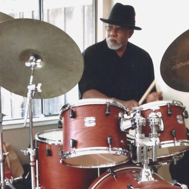 Jym Marks sits behind a drum kit in an undated photo. The Jym Marks Quintet will give a free performance in Menlo Park City Council chambers Saturday, starting at 11 a.m. (Jym Marks)