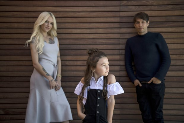 """Bria Vinaite, left, and Brooklynn Prince, center, who star in """"The Florida Project,"""" with the film's director, Sean Baker. (Carolyn Van Houten/WashingtonPost)"""