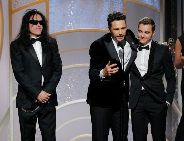 """Best actor in a motion picture, musical or comedy — JAMES FRANCO (center, with Tommy Wiseau, left, and Dave Franco), """"The Disaster Artist."""" (Paul Drinkwater/NBC via AP)"""