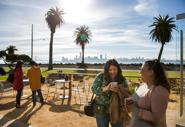 Party guests enjoy the outdoor view at Mersea on Treasure Island in San Francisco, California, on Saturday, January 13, 2018. (LiPo Ching/Bay Area News Group)