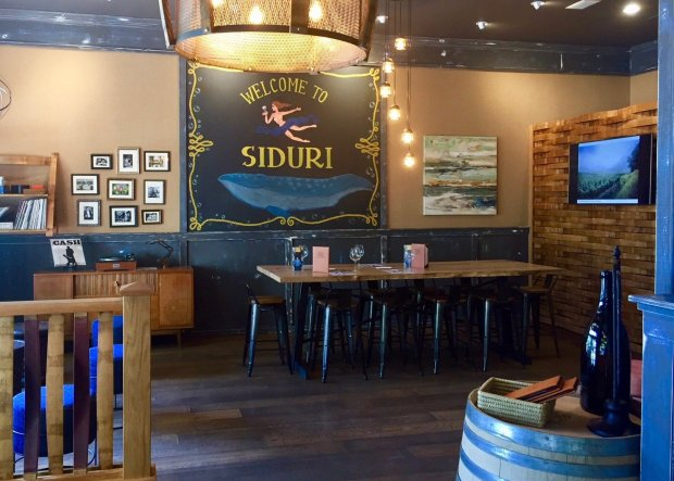 Healdsburg's Siduri Wine Lounge offers tastings in its spacious,nautically-themed bar or on a cozy couch in the rock-and-roll lounge. (Jessica Yadegaran/Bay Area News Group)