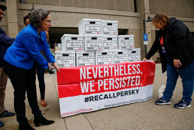 Michele Dauber and Doreen Shrivastava, left to right, prepare to hand 11 boxes with nearly 95,000 signatures to place the recall of Judge Aaron Persky on the June ballot at a rally at the Santa Clara County Registrar of Voters office in San Jose, California, on Thursday, Jan. 11, 2017. (Gary Reyes/ Bay Area News Group)