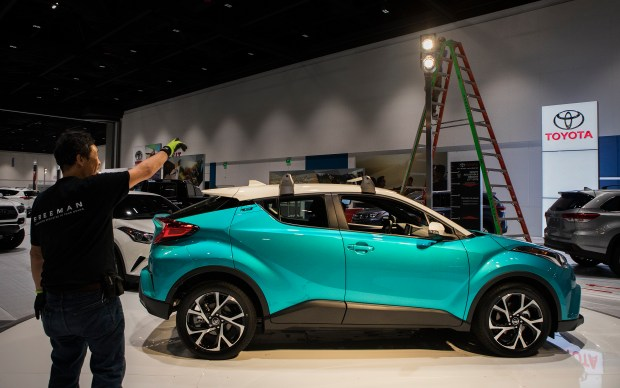 A setup crew from Freeman set the lights on a Toyota C-HR in preparation for the Silicon Valley Auto Show at the San Jose McEnery Convention Center in San Jose, California on Wednesday, January 3, 2018. (LiPo Ching/Bay Area News Group)