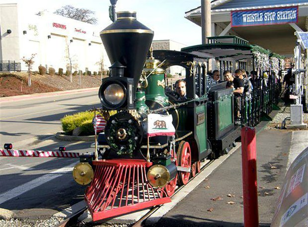 The former Frontier Village train photographed taking passengers for a loop around Burke Junction, a shopping area in Cameron Park, Calif. (Courtesy Burke Junction)