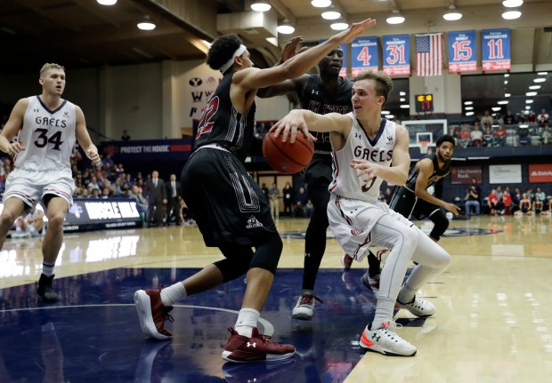 Saint Mary's guard Emmett Naar, right, looks to pass to teammate Jock Landale (34) as New Mexico State forward Eli Chuha (22) defends during the second half of an NCAA college basketball game Monday, Nov. 13, 2017, in Moraga, Calif. (AP Photo/Marcio Jose Sanchez)