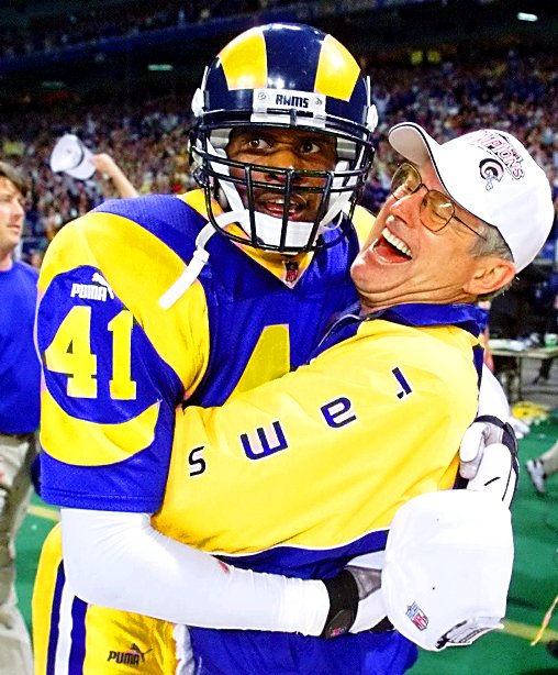 St. Louis Rams head coach Dick Vermeil celebrates with Todd Lyght after the Rams beat the Tampa Bay Buccaneers 11-6 in the NFC Championship game, Sunday, Jan. 23, 2000 in St. Louis. (AP Photo/Michael Conroy)