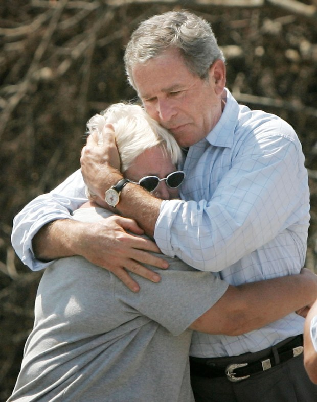 BILOXI, MS - SEPTEMBER 2: U.S. President George W. Bush hugs hurricane victim Sandra Patterson, whose home was destroyed, September 2, 2005 in Biloxi, Mississippi. Bush visited the town of Biloxi, in parts completely devastated, during his tour of the Gulf Coast to view damage caused by Hurricane Katrina. (Photo by Win McNamee/Getty Images) *** Local Caption *** George W. Bush;Sandra Patterson