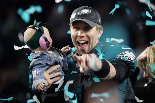 Nick Foles #9 of the Philadelphia Eagles celebrates with his daughter Lily Foles after his 41-33 victory over the New England Patriots in Super Bowl LII at U.S. Bank Stadium on February 4, 2018 in Minneapolis, Minnesota. The Philadelphia Eagles defeated the New England Patriots 41-33. (Photo by Rob Carr/Getty Images)