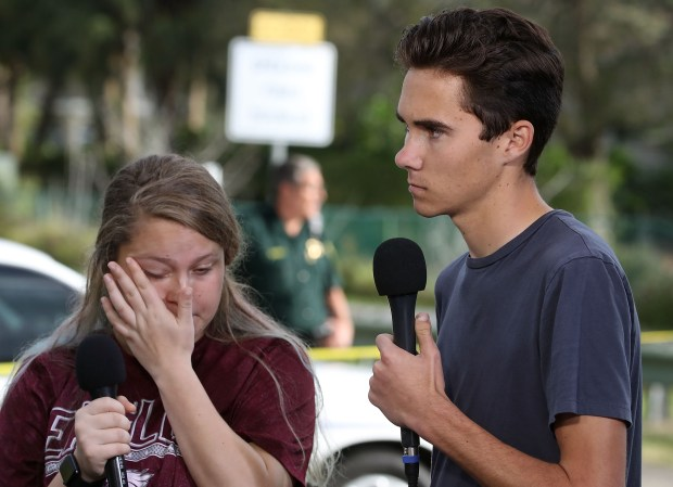 Students Kelsey Friend (L) and David Hogg recount their stories about yesterday's mass shooting at the Marjory Stoneman Douglas High School where 17 people were killed, on February 15, 2018 in Parkland, Florida. Police arrested the suspect after a short manhunt, and have identified him as 19 year old former student Nikolas Cruz. (Photo by Mark Wilson/Getty Images)