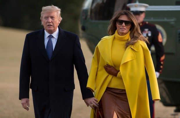 US President Donald Trump and First Lady Melania Trump walk across the South Lawn upon arrival on Marine One at the White House in Washington, DC, February 5, 2018, following a tripl to Ohio. / AFP PHOTO / SAUL LOEBSAUL LOEB/AFP/Getty Images