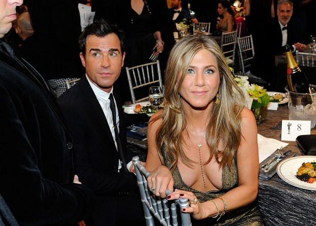 Actors Justin Theroux (L) and Jennifer Aniston attend the 21st Annual Screen Actors Guild Awards at The Shrine Auditorium on January 25, 2015 in Los Angeles, California. (Photo by Kevork Djansezian/Getty Images)