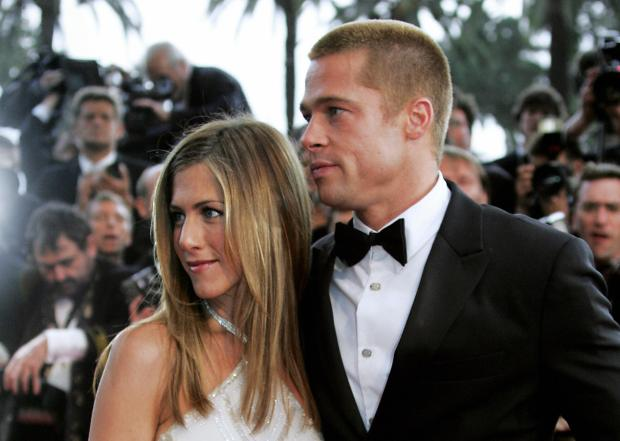 """CANNES, France: US actor Brad Pitt and his wife Jennifer Aniston to attend the official projection of US director Wolfgang Petersen's film """"Troy"""", 13 May 2004, at the 57th Cannes Film Festival in the French Riviera town. Hollywood took over the French Riviera today as Brad Pitt and his co-stars of the epic movie arrived to present their 175 million dollar (147 million euro)-plus swords-and-sandals feature, being shown out of competition, in the blaze of Cannes publicity. AFP PHOTO/FRANCOIS GUILLOT (Photo credit should read FRANCOIS GUILLOT/AFP/Getty Images)"""